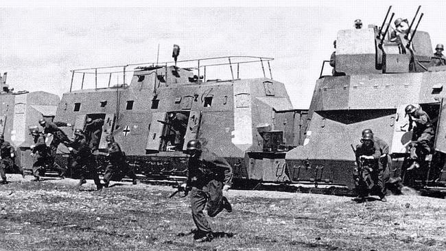 Mobile bastion ... German soldiers leap to action for the cameras in front of an armoured train during World War II. Source: US National Archive