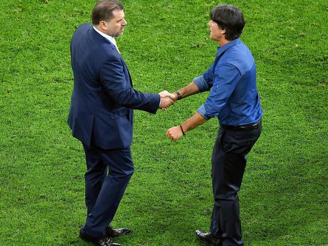 Germany's coach Joachim Loew shakes hands with Australia's coach Ange Postecoglou.