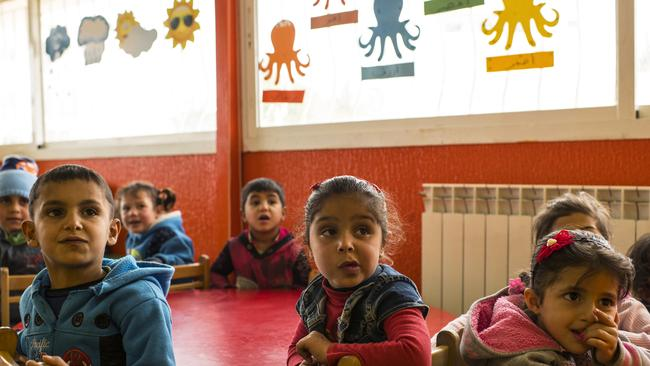 Syrian refugee children listen to their teacher at one of 10 Early Childhood Education centres supported by World Vision in Lebanon's Beqaa Valley. Picture: World Vision