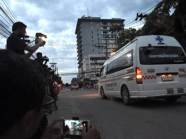 An ambulance transporting some of the boys pproaches the hospital in the northern Thai city of Chiang Rai. Picture: AFP