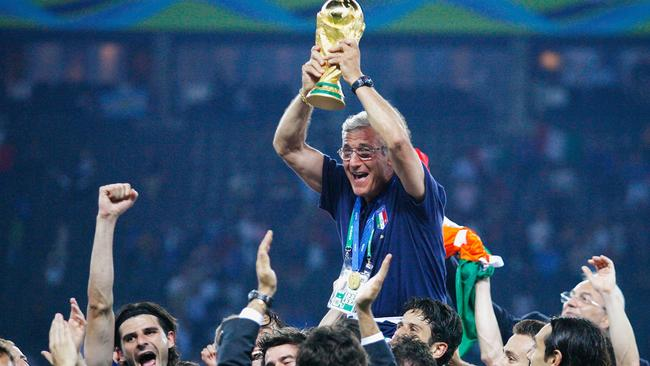 The Italian players celebrate as Marcello Lippi the coach lifts the World Cup trophy in 2006.