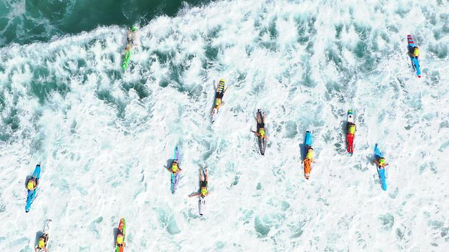 Competitors make their way through the white wash at the Australian Surf Life Saving Championships. Picture: HarvPix