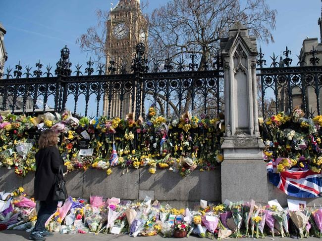 Floral tributes to the victims of the March 22 terror attack are seen outside the Houses of Parliament in Westminster, central London. Picture: AFP / Justin Tallis