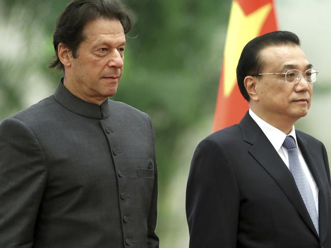 Pakistan's Prime Minister Imran Khan, left, and Chinese Premier Li Keqiang in Beijing. China is a longtime ally of Pakistan and invests heavily in it. Picture: AP Photo