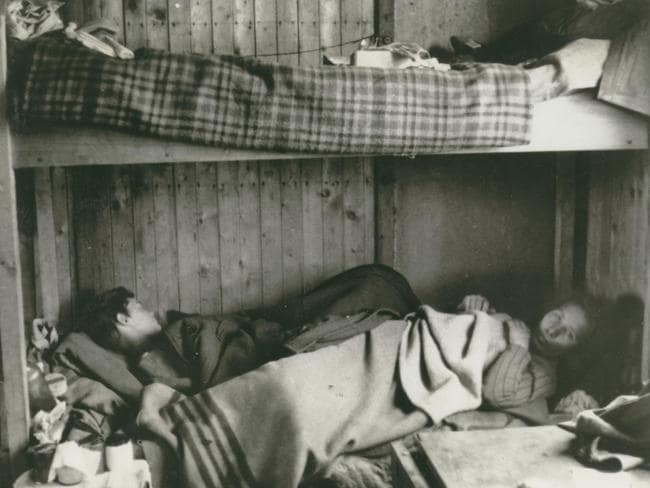 Two women laying in a bunk in the Bergen-Belsen Concentration Camp. Living conditions were cramped. Picture: Sydney Jewish Museum Collection