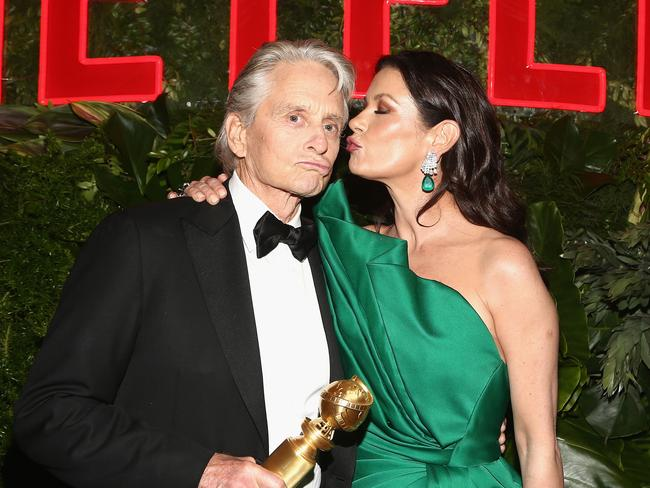 Michael Douglas and Catherine Zeta-Jones pucker up at the Netflix bash. Picture: Getty Images