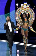SHANGHAI, CHINA - NOVEMBER 20: Singer Miguel and model Leomie Anderson walk the runway during the 2017 Victoria's Secret Fashion Show In Shanghai at Mercedes-Benz Arena on November 20, 2017 in Shanghai, China. (Photo by Frazer Harrison/Getty Images for Victoria's Secret)