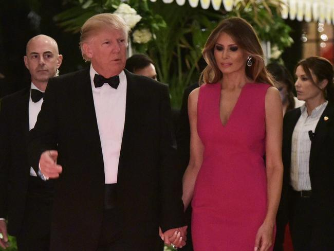 The presidential couple pictured hand-in-hand at Saturday night's Red Cross Gala. Picture: Mandel Ngan/AFP