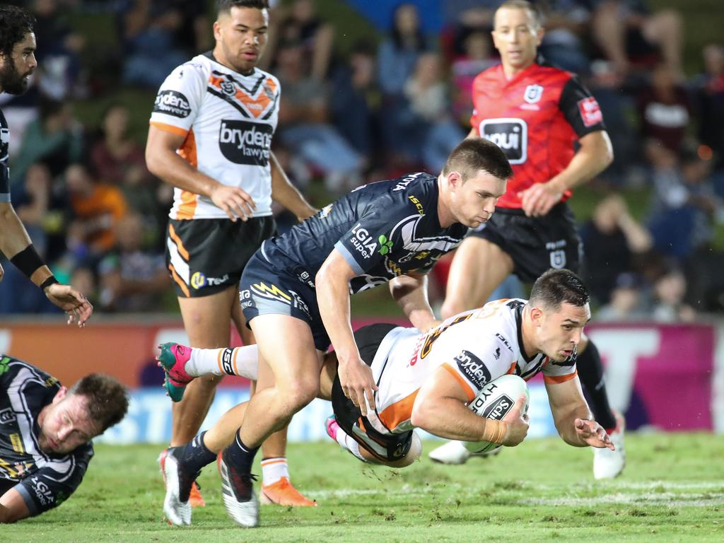Ryan Matterson of the Tigers is tackled by Tom Opacic of the Cowboys during the Round 14 NRL match between the North Queensland Cowboys and the Wests Tigers at 1300SMILES Stadium in Townsville, Friday June 14, 2019. (AAP Image/Michael Chambers) NO ARCHIVING, EDITORIAL USE ONLY