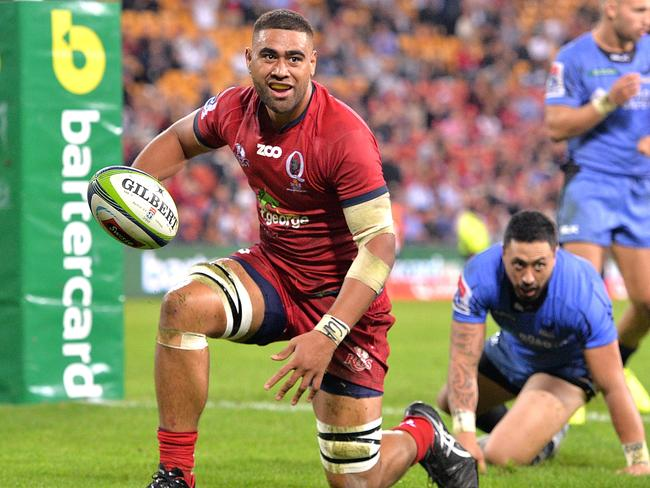Lukhan Tui celebrates scoring for the Reds against the Force.