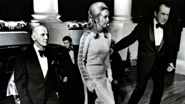 US president Richard Nixon escorts Sonia McMahon, wearing the daring dress designed by Victoria Cascajo, into the White House as husband Australian PM William McMahon follows.