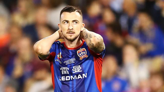 Newcastle Jets striker Roy O'Donovan after missing a chance.