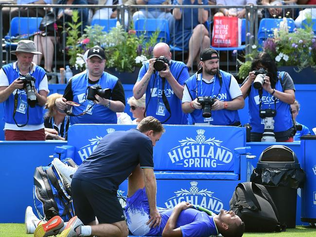 Australia's Nick Kyrgios receives medical treatment.