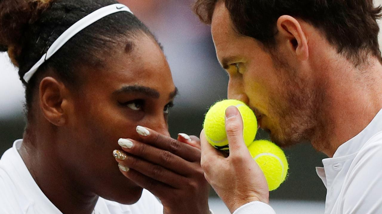 Britain's Andy Murray (R) and US player Serena Williams (L) speak between points against France's Fabrice Martin and US player Raquel Atawo.