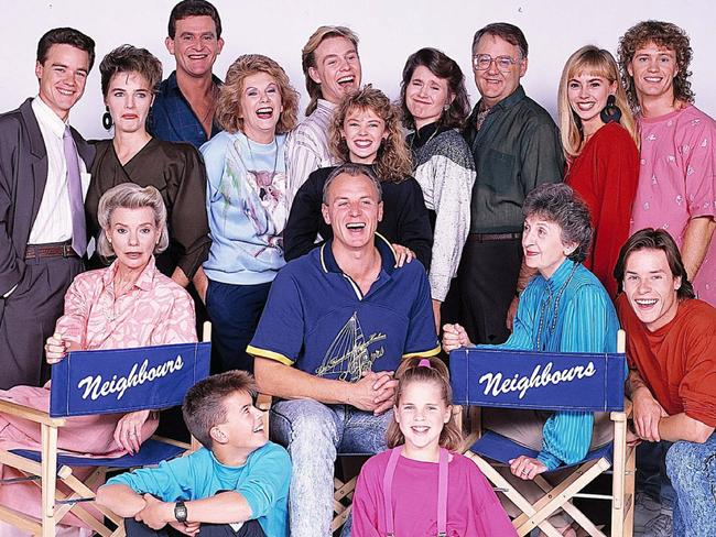 Cast of Neighbours in 1987 (back l-r) Stefan Dennis with Fiona Corke, Paul Keane, Anne Charleston, Jason Donovan, Kylie Minogue, Lisa Armytage, Ian Smith, Annie Jones, Craig McLachlan, (front l-r) Anne Haddy, Kristian Schmidt, Alan Dale, Katie Landers, Vivean Gray and Guy Pearce. Picture: Supplied