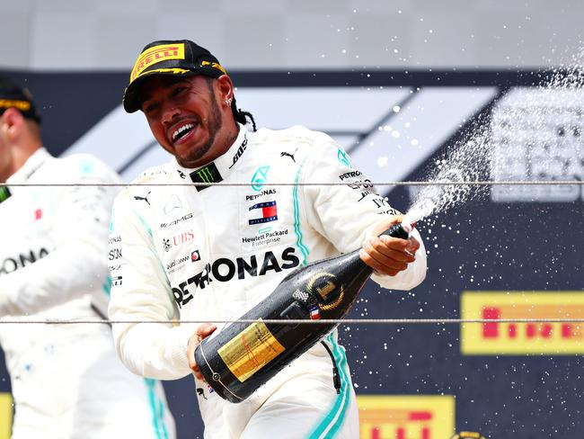 Lewis Hamilton never gets sick of spraying champagne.
