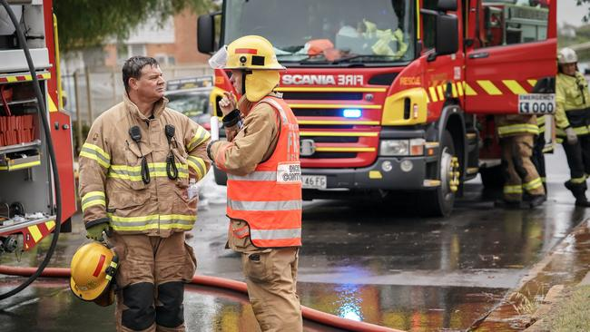 Firefighters at the scene in Elizabeth East. Picture: AAP/MIKE BURTON