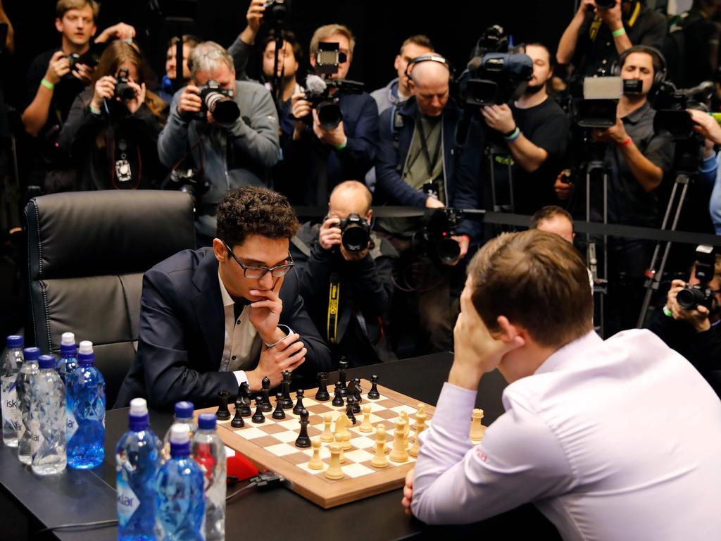 Magnus Carlsen and Fabiano Caruana playing the first game of the tie-break matches of the 2018 World Chess Championship.