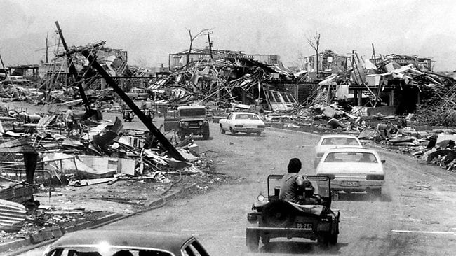 Then Prime Minister Gough Whitlam (first car) inspects a wrecked suburb of Darwin after Cyclone Tracy. Picture: NT News