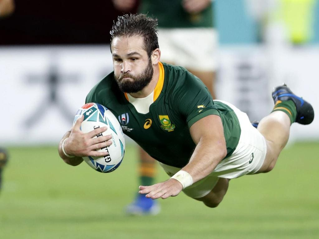 South Africa's Cobus Reinach is airborne as dives to the line to score a try during the Rugby World Cup Pool B game at Kobe Misaki Stadium between South Africa and Canada in Kobe, Japan, Tuesday, Oct. 8, 2019. (Kyodo News via AP)