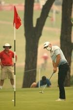 Ryan Chisnall of New Zealand wearing a face mask due to smoke haze during the first round of The Australian Open Golf Championships at The Australian Golf Club, Sydney. Picture: Phil Hillyard