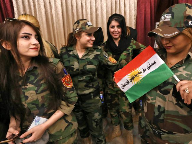 Female members of a Kurdish Peshmerga battalion queue inside a polling station as they wait to cast their vote in the Kurdish independence referendum in Arbil, on September 25. Picture: AFP / SAFIN HAMED