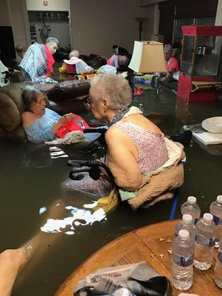 Residents in water at a nursing home. Picture: Timothy McIntosh