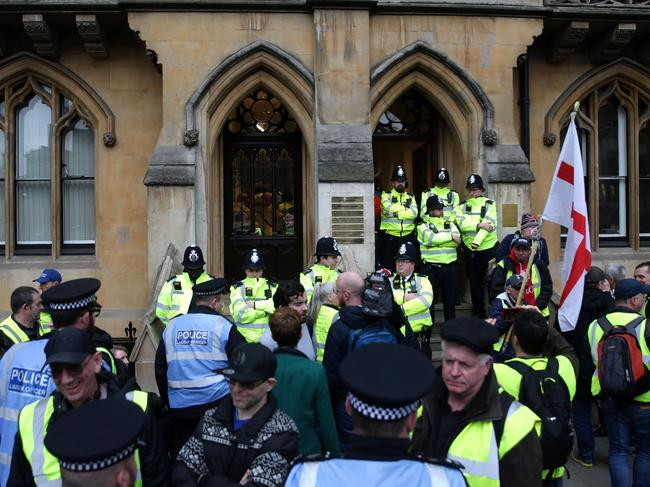 Police officers on duty as demonstrators wearing yellow vests protest inside and outside of the offices of Britain's Attorney-General, in London. Picture: AFP