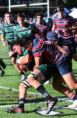 BBC lock Jacob Blyton tackled by TSS prop George Blake. GPS Rugby: Brisbane Boys' College v The Southport School at BBC Saturday 24th August 2019. (AAP Image - Richard Waugh)