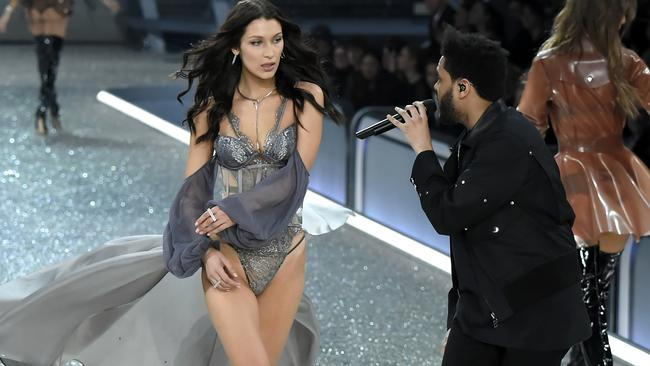 Bella Hadid and The Weeknd on stage during the 2016 Victoria's Secret Fashion Show in Paris. Picture: Kristy Sparow, WireImage.