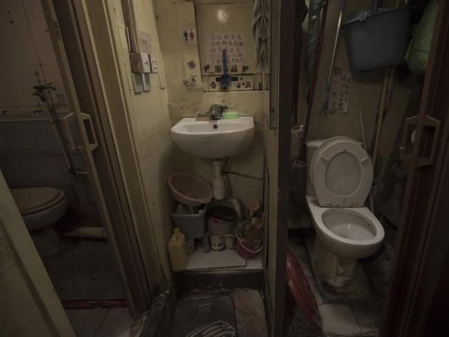 A set of grimy toilets and single sink shared by the coffin home's two dozen inhabitants, including a few single women, is located at a flat in Hong Kong. Picture: Kin Cheung/AP