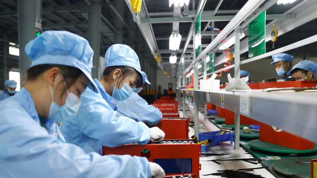 Employees in the workshop of a lithium battery manufacturing company in Huaibei, eastern China's Anhui province. Picture: AFP