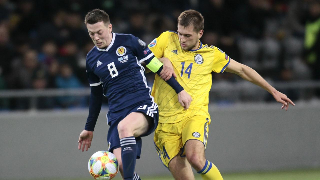 Scotland's Callum McGregor, left, challenges for the ball as Scotland were humbled by lowly Kazakhstan in the opening round of Euro 2020 qualifiers.