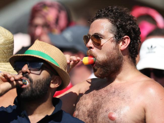 The Barmy Army eat ice creams on a very hot Sydney day.