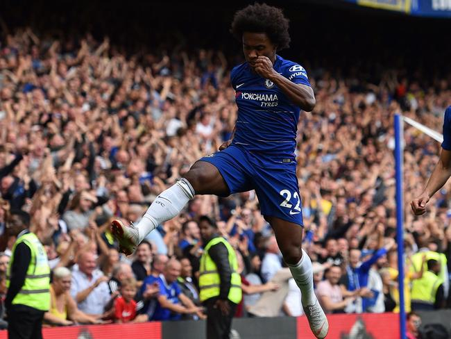 Chelsea's Brazilian midfielder Willian celebrates scoring his team's fourth goal against Cardiff City at Stamford Bridge. Picture: AFP