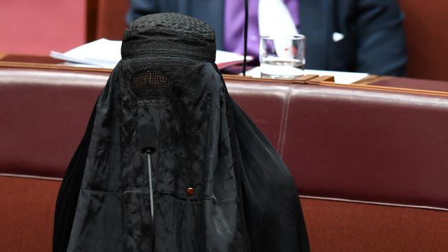 Pauline Hanson wearing a burqa during Senate Question Time in 2017. Picture: Lukas Coch/AAP.
