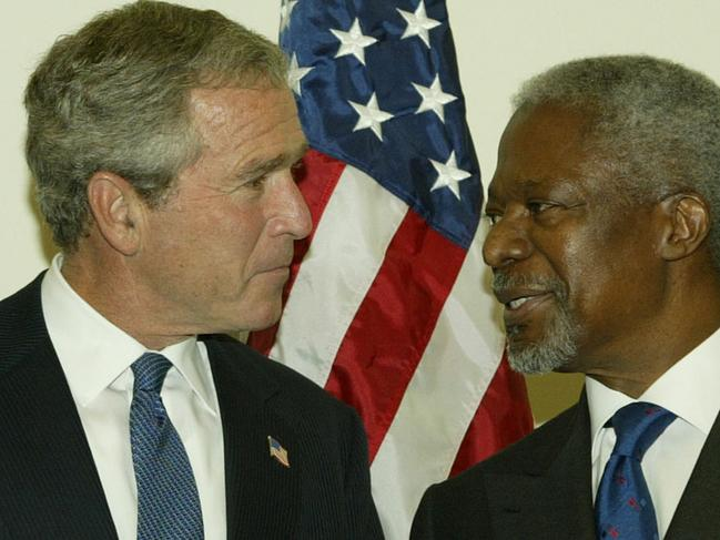 Former UN Secretary General Kofi Annan greets President George W Bush at United Nations headquarters in New York in 2003. Picture: AP