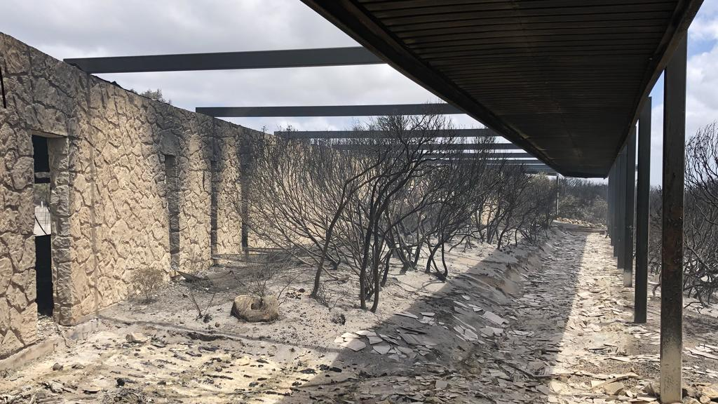 There's nothing left of the lodge's long interior walkway after the bushfire.
