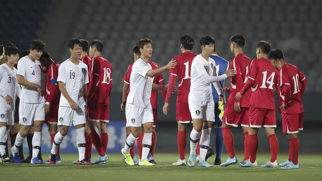 The players shake hands after the scoreless draw.