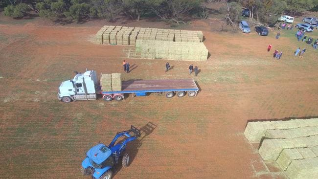 Hay and feed pellets are delivered to drought-struck farmers at Eudunda. Picture: Tristan Zerber