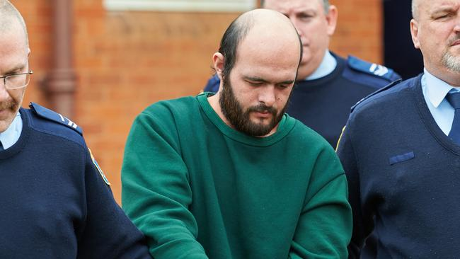 Marcus Stanford, the identical twin brother of Stephanie Scott killer Vincent Stanford, is led into court in Leeton, NSW.