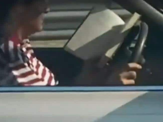 Not novel, but this driver has no qualms about reading a book he obviously can't put down. Picture: A Current Affair.