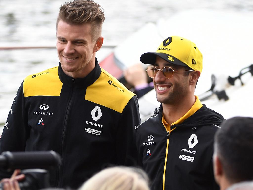 Renault's German driver Nico Hulkenberg (L) and Australian driver Daniel Ricciardo (R) arrive for an F1 live event to introduce drivers and team principals in Melbourne on March 13, 2019, ahead of the Formula One Australian Grand Prix. (Photo by William WEST / AFP) / -- IMAGE RESTRICTED TO EDITORIAL USE - STRICTLY NO COMMERCIAL USE --