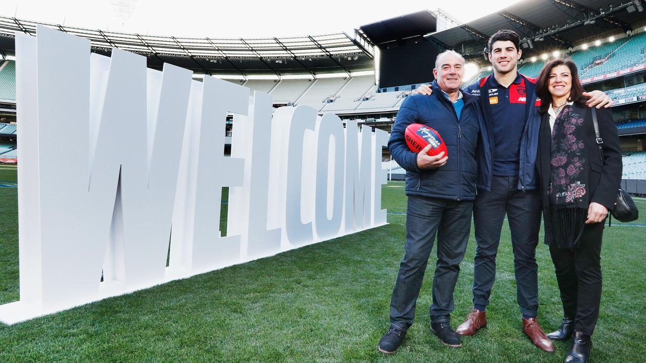 Christian Petracca with his dad Tony and mum Elvira. Picture: Michael Dodge
