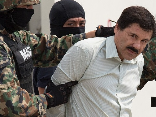 The drug trafficker Joaquin Guzman Loera, El Chapo, looks at the press as he is arrested. Picture: Supplied