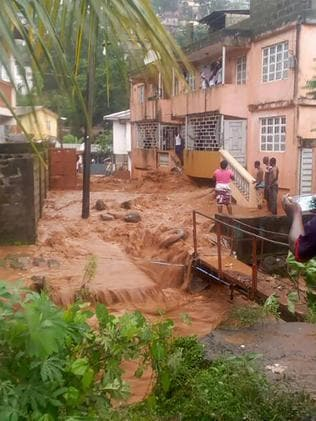 This picture shows flooded streets in Regent near Freetown. Picture: AFP