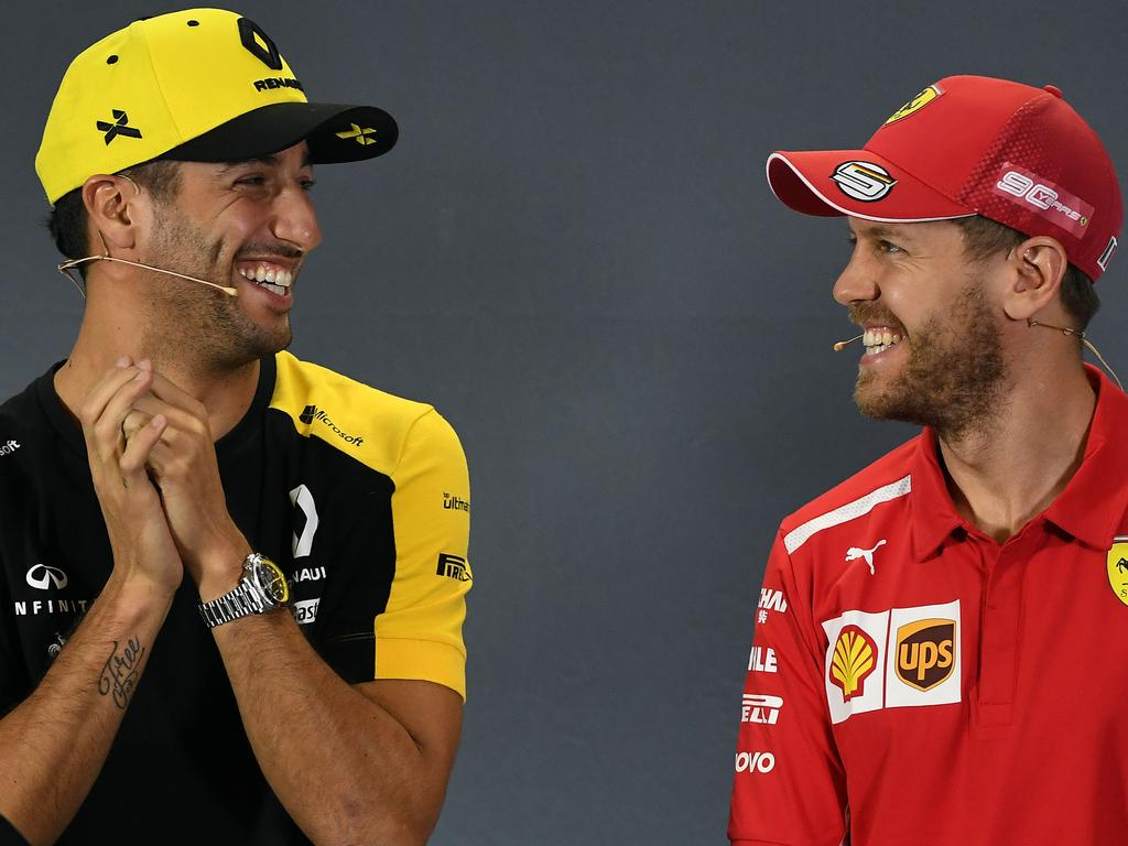 Ferrari's German driver Sebastian Vettel (R) and Renault's Australian driver Daniel Ricciardo attend a press conference in Melbourne on March 14, 2019, ahead of the Formula One Australian Grand Prix. (Photo by William WEST / AFP) (Photo credit should read WILLIAM WEST/AFP/Getty Images)