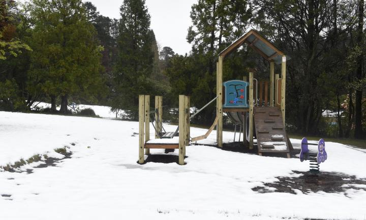 Snow falls in Blackheath in the upper Blue Mountains of NSW. Ice and snow surrounds the playground equipment in Memorial Park. Photo by Matt Sullivan.