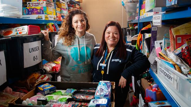 Treasure Boxes charity founder Rikki Cooke and Blakeview Primary School Counsellor Jayde Milburn at the Treasure Boxes warehouse.