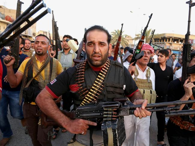For the defence ... Iraqi Shiite tribal fighters deploy with their weapons to help the military in Baghdad.